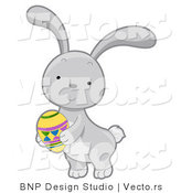 Cartoon Vector of a Gray Rabbit with Easter Egg by BNP Design Studio