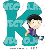 Vector of a Boy Beside Alphabet Letter K by BNP Design Studio