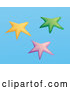Vector of Yellow, Pink and Blue Group of Starfish on a Blue Background by Rasmussen Images